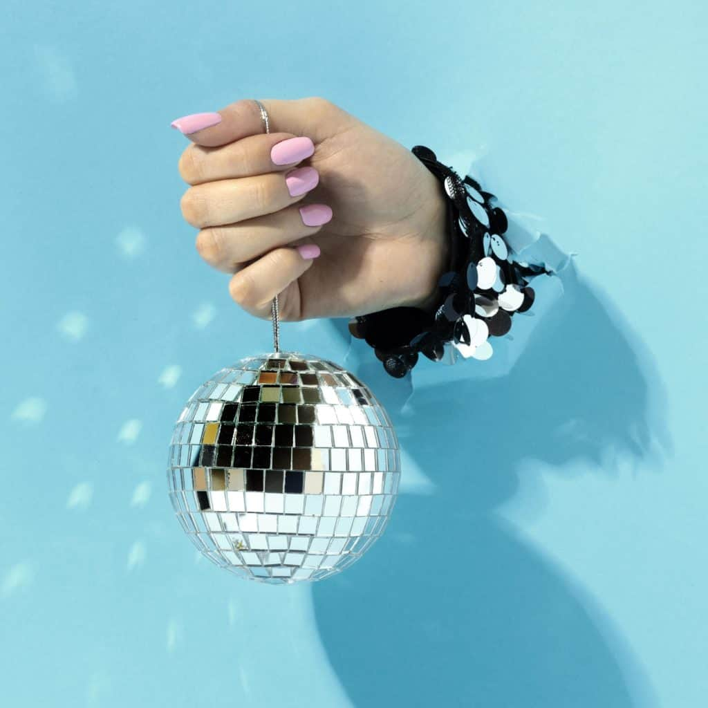 close up hand with disco ball